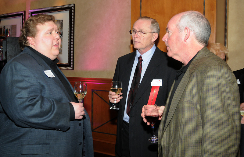 Chris Luchs, left, chats with Allan Noell and Dave Smith during the Broomfield Chamber of Commerce annual dinner at the Renaissance Boulder Suites Hotel on Friday.<br />  <br /> January 22, 2010<br /> Staff photo/David R. Jennings