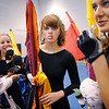 Broomfield High's Color Guard take mints to suck on for good luck before their performance at the Rocky Mountain Color Guard Assoc. State competition at Legacy High School on Saturday.<br /> <br /> March 27, 2010<br /> Staff photo/David R. Jennings