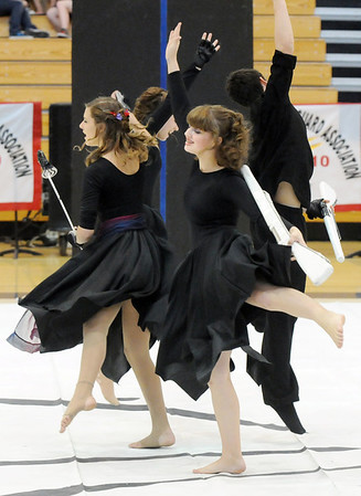 Broomfield High's Color Guard use swords and rifles during their performance at the Rocky Mountain Color Guard Assoc. State competition at Legacy High School on Saturday.<br /> <br /> March 27, 2010<br /> Staff photo/David R. Jennings