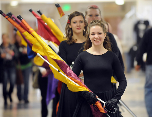 Maggie Admire leads the Broomfield High's Color Guard to the warm-up area at the Rocky Mountain Color Guard Assoc. State competition at Legacy High School on Saturday.<br /> <br /> March 27, 2010<br /> Staff photo/David R. Jennings