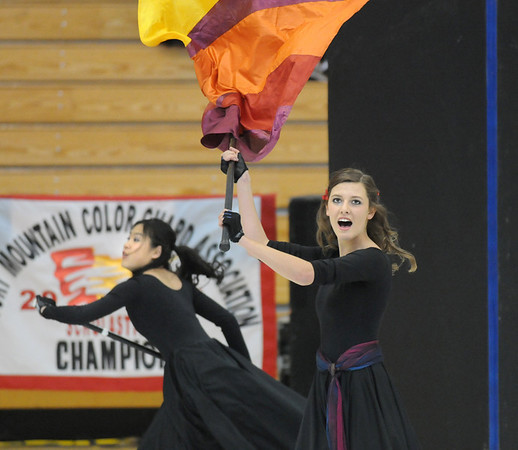 Julie Brandenburg, right, twirls a flag as Molly Oitges dances during  Broomfield High's Color Guard performance at the Rocky Mountain Color Guard Assoc. State competition at Legacy High School on Saturday.<br /> <br /> March 27, 2010<br /> Staff photo/David R. Jennings