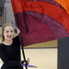 Bridget Admire twirls a flag during Broomfield High's Color Guard performance at the Rocky Mountain Color Guard Assoc. State competition at Legacy High School on Saturday.<br /> <br /> March 27, 2010<br /> Staff photo/David R. Jennings
