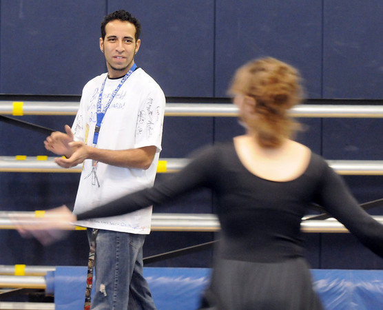 Gabe Gonzales, claps for timing during Broomfield High's Color Guard warm-up before performing at the Rocky Mountain Color Guard Assoc. State competition at Legacy High School on Saturday/<br /> <br /> March 27, 2010<br /> Staff photo/David R. Jennings