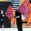 Hayden Schappell, right, and Maren Philip dance using their flags during  Broomfield High's Color Guard performance at the Rocky Mountain Color Guard Assoc. State competition at Legacy High School on Saturday.<br /> <br /> March 27, 2010<br /> Staff photo/David R. Jennings