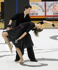 Hayden Schappell, left, and Julie Brandenburg dance during Broomfield High's Color Guard performance at the Rocky Mountain Color Guard Assoc. State competition at Legacy High School on Saturday.  March 27, 2010 Staff photo/David R. Jennings