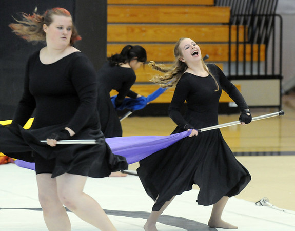 Janell Fairchild, left, and Bridget Admire dance with their flags during Broomfield High's Color Guard performance at the Rocky Mountain Color Guard Assoc. State competition at Legacy High School on Saturday/<br /> <br /> March 27, 2010<br /> Staff photo/David R. Jennings
