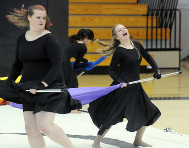 Janell Fairchild, left, and Bridget Admire dance with their flags during Broomfield High's Color Guard performance at the Rocky Mountain Color Guard Assoc. State competition at Legacy High School on Saturday/  March 27, 2010 Staff photo/David R. Jennings