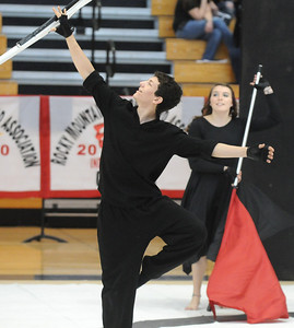 Hayden Schappell catches a rifle while Sydnee Marnich works wiht a flag during Broomfield High's Color Guard performance at the Rocky Mountain Color Guard Assoc. State competition at Legacy High School on Saturday.  March 27, 2010 Staff photo/David R. Jennings