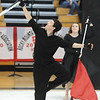 Hayden Schappell catches a rifle while Sydnee Marnich works wiht a flag during Broomfield High's Color Guard performance at the Rocky Mountain Color Guard Assoc. State competition at Legacy High School on Saturday.<br /> <br /> March 27, 2010<br /> Staff photo/David R. Jennings