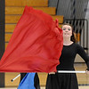 Sydnee Marnich twirls a flag during Broomfield High's Color Guard performance at the Rocky Mountain Color Guard Assoc. State competition at Legacy High School on Saturday.<br /> <br /> March 27, 2010<br /> Staff photo/David R. Jennings