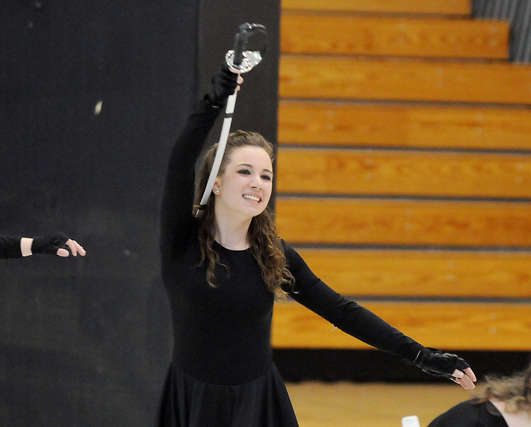 Maggie Admire, center, catches a sword during Broomfield High's Color Guard performance at the Rocky Mountain Color Guard Assoc. State competition at Legacy High School on Saturday/<br /> <br /> March 27, 2010<br /> Staff photo/David R. Jennings