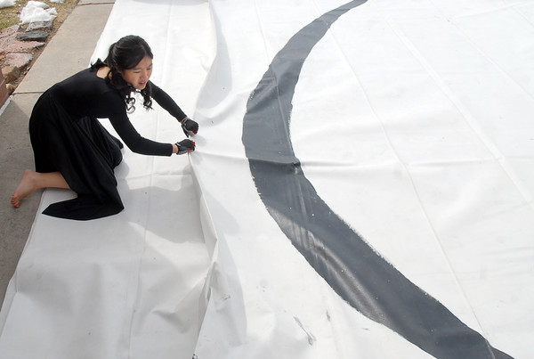 Molly Oitges, 15, helps fold the Broomfield Color Guard mat after their performance at the Rocky Mountain Color Guard Assoc. State competition at Legacy High School on Saturday/<br /> <br /> March 27, 2010<br /> Staff photo/David R. Jennings
