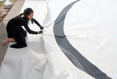 Molly Oitges, 15, helps fold the Broomfield Color Guard mat after their performance at the Rocky Mountain Color Guard Assoc. State competition at Legacy High School on Saturday/  March 27, 2010 Staff photo/David R. Jennings