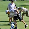 Darrell Giebler, left,  Broadlands, picks up the hole flag while Jeff Bazinet, Eagle Trace, picks up his ball with Dan Noreen, Broadlands, in the middle after playing the 1st green  during Saturday's Broomfield Cup Golf Tournament between players from the Broadlands Golf Course and Eagle Trace Golf Course held at Eagle Trace Golf Course.<br /> <br /> July 21, 2012<br /> staff photo/ David R. Jennings