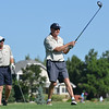 Eagle Trace team members Paul Carr, right, tees off the second tee, while Brian Kerr watches during Saturday's Broomfield Cup Golf Tournament between players from the Broadlands Golf Course and Eagle Trace Golf Course held at Eagle Trace Golf Course.<br /> <br /> July 21, 2012<br /> staff photo/ David R. Jennings