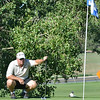 Andy Laker with the Eagle Trace team, studies the first  green during Saturday's Broomfield Cup Golf Tournament between players from the Broadlands Golf Course and Eagle Trace Golf Course held at Eagle Trace Golf Course.<br /> <br /> July 21, 2012<br /> staff photo/ David R. Jennings