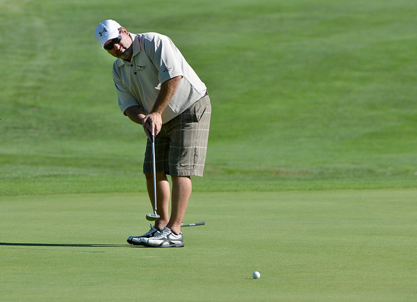 Jeff Bazinet, EAgle Trace team, make a putt during Saturday's Broomfield Cup Golf Tournament between players from the Broadlands Golf Course and Eagle Trace Golf Course held at Eagle Trace Golf Course.<br /> <br /> July 21, 2012<br /> staff photo/ David R. Jennings