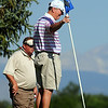 Rich Buel, right, Broadlands holds the flag while Art Cain, Eagle Trace watches during Saturday's Broomfield Cup Golf Tournament between players from the Broadlands Golf Course and Eagle Trace Golf Course held at Eagle Trace Golf Course.<br /> <br /> July 21, 2012<br /> staff photo/ David R. Jennings