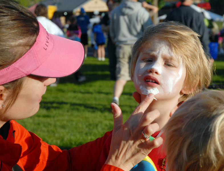 Brode Gustafson, 4,  has his clown make-up put on by his mother, Jennifer before the Optimist's Clown Contest during Broomfield Days at Midway Park on Saturday.<br /> <br /> Sept. 19, 2009<br /> Staff photo/David R. Jennings