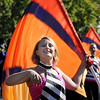 Danica Spicer twirls a flag while marching with the Broomfield High School Band during the parade at Broomfield Days at Midway Park on Saturday.<br /> <br /> Sept. 19, 2009<br /> Staff photo/David R. Jennings
