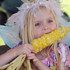 Una Tholson, 4, eats corn during Broomfield Days at Midway Park on Saturday.<br /> <br /> Sept. 19, 2009<br /> Staff photo/David R. Jennings