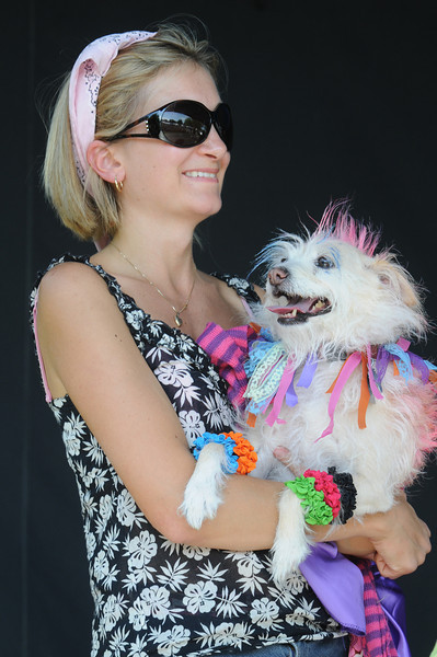 Vanessa Mahoney holds her dog Tonka dressed as the rock star Cyndi Lauper during the Best Dressed Dog contest at Broomfield Days at Midway Park on Saturday.<br /> <br /> Sept. 19, 2009<br /> Staff photo/David R. Jennings