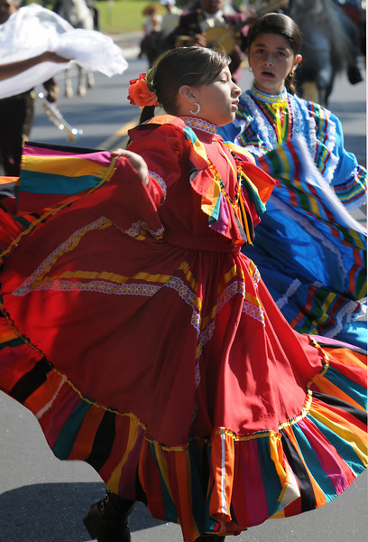 Paulina Villasenor, 9, performs a traditional Mexican dance with 3 Margarittas during  the parade at Broomfield Days at Midway Park on Saturday.<br /> <br /> Sept. 19, 2009<br /> Staff photo/David R. Jennings