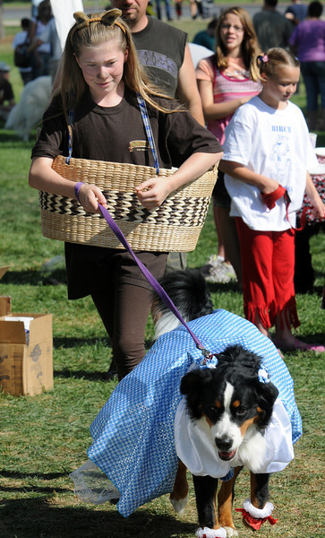 Erin Mahler, 11, dressed as Toto and her dog Tiny, was dressed as Dorothy for the Best Dressed Dog Contest during Broomfield Days at Midway Park on Saturday.<br /> <br /> <br /> Sept. 19, 2009<br /> Staff photo/David R. Jennings