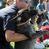 Broomfield police officer Mike Traudt wtches the Dock Dogs competition with his dog Weatherby a Greman short hair pointer  during Broomfield Days at Midway Park on Saturday.<br /> <br /> Sept. 19, 2009<br /> Staff photo/David R. Jennings