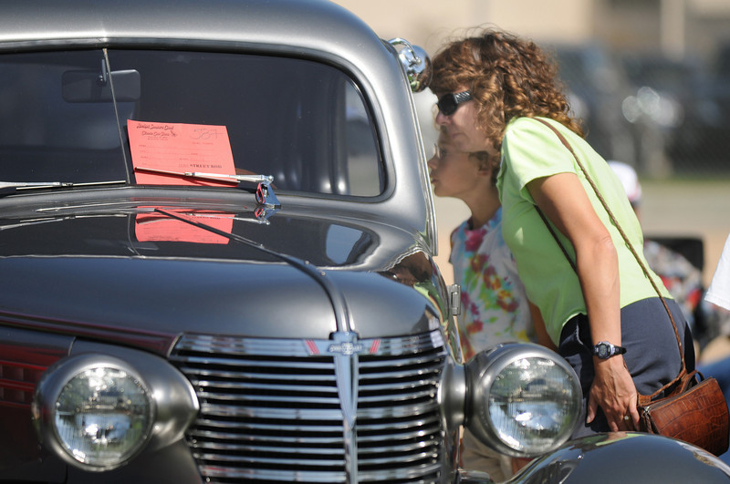 Barb Hansen looks at a 38' Chevy coupe at the car show during Broomfield Days at Midway Park on Saturday.<br /> <br /> Sept. 19, 2009<br /> Staff photo/David R. Jennings