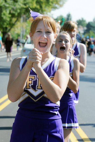 Holy Family's Emily Elliott leads a cheer while marching in the parade during Broomfield Days on Saturday.<br /> <br /> Sept. 19, 2009<br /> Staff photo/David R. Jennings