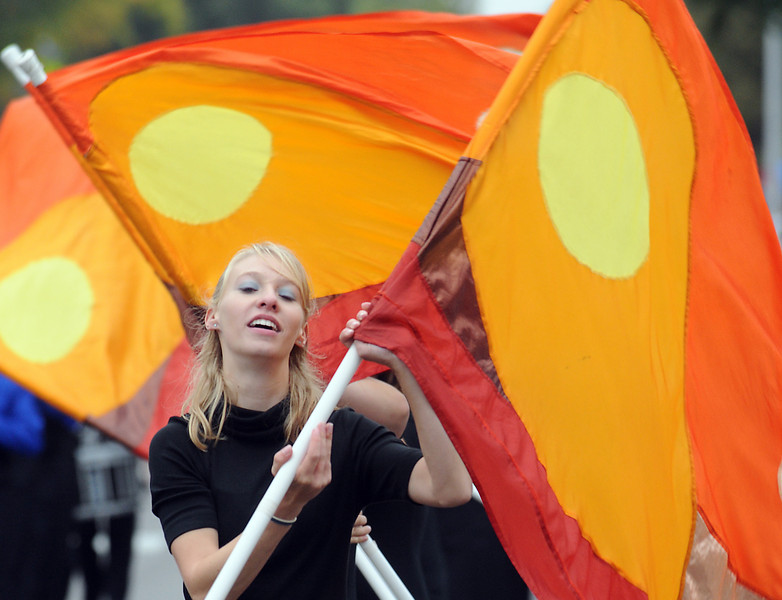 Broomfield High flag team member Kayla Hampel twirls a flag while marching in the parade at Broomfield Days on Saturday.<br /> <br /> September 18, 2010<br /> staff photo/David R. Jennings