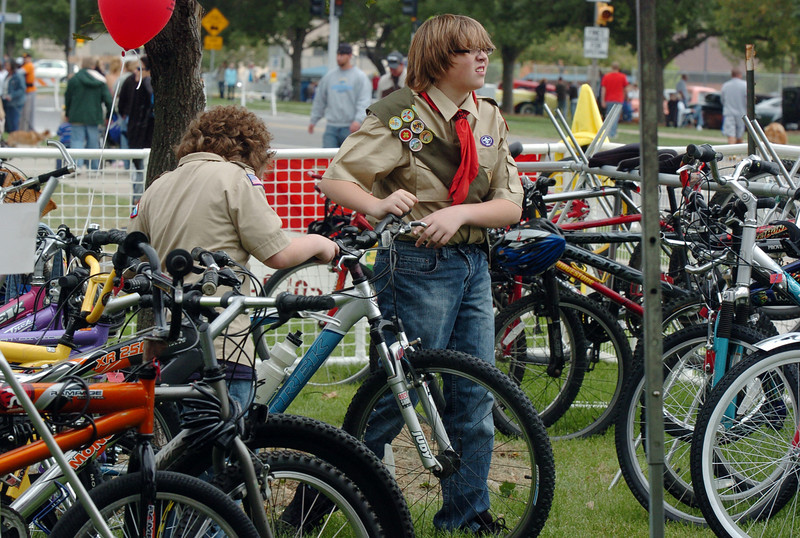 Boy Scouts Jordan Dragland, 15, right, and Alex King park bicycles in the bike corral at Broomfield Days on Saturday.<br /> <br /> September 18, 2010<br /> staff photo/David R. Jennings
