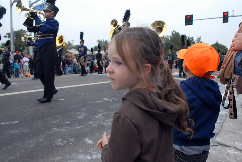 Lydia Dahlke, 3, watches the Legacy High band march by during the parade at Broomfield Days on Saturday.<br /> <br /> September 18, 2010<br /> staff photo/David R. Jennings