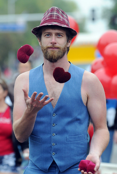 Mark Crisman juggles with the the Ascential Dance Theatre entry in the parade at Broomfield Days on Saturday.<br /> <br /> September 18, 2010<br /> staff photo/David R. Jennings