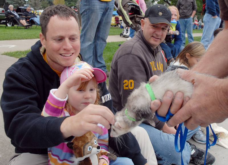 Keith Holley and his daughter Brianna, 5, pet a ferret held by Animal Doctor's Dave Severs during the parade at Broomfield Days on Saturday.<br /> <br /> September 18, 2010<br /> staff photo/David R. Jennings