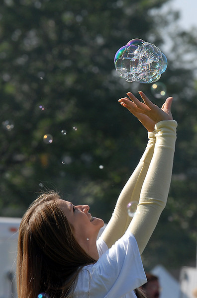 Nela Miocevic, 14, plays with bubbles from the bubble tower at Broomfield Days on Saturday.<br /> <br /> September 18, 2010<br /> staff photo/David R. Jennings