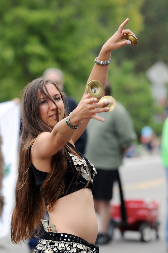 Kasbah Moroccan restaurant belly dancer Melissa Walker dances during the parade at Broomfield Days on Saturday.<br /> <br /> September 18, 2010<br /> staff photo/David R. Jennings