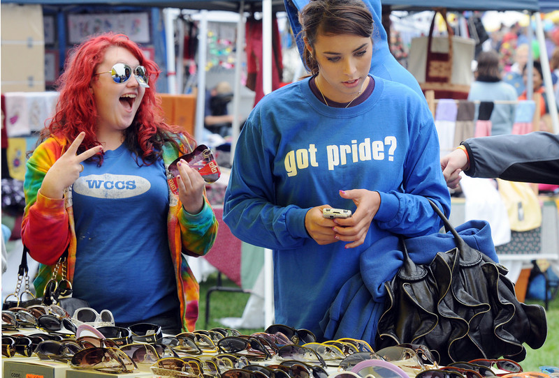 Ester Ingils, 16, left, and Jessica Whitcomb, 19 shop for sunglasses at a booth at Broomfield Days on Saturday.<br /> <br /> September 18, 2010<br /> staff photo/David R. Jennings