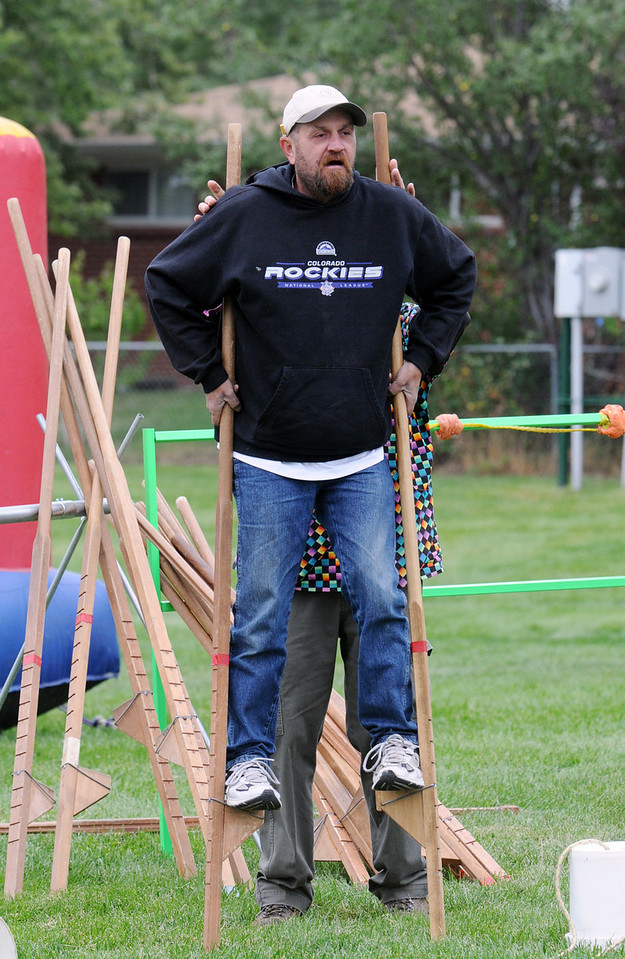 J. D. Moore tries out the stilts at Broomfield Days on Saturday.<br /> <br /> September 18, 2010<br /> staff photo/David R. Jennings