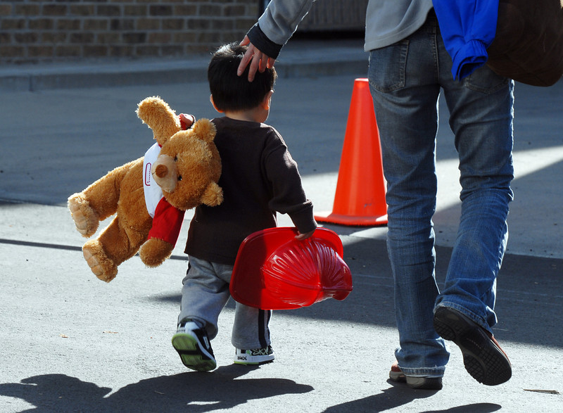 A boy and his mother walk home after Broomfield Days on Saturday.<br /> <br /> September 18, 2010<br /> staff photo/David R. Jennings