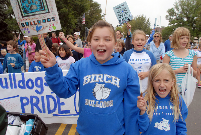 Anne Abeyta, 9, left, and Bree Geist, 9, cheer for the Birch Elementary Bulldogs during the parade at Broomfield Days on Saturday.<br /> <br /> September 18, 2010<br /> staff photo/David R. Jennings