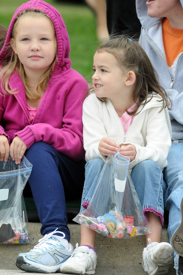 Julia Flanagan, 7, left, and her sister Savanna, 5, watch the parade holding bags of candy tossed to them during the parade at Broomfield Days on Saturday.<br /> <br /> September 18, 2010<br /> staff photo/David R. Jennings