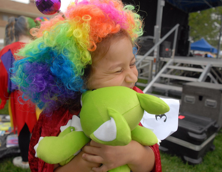 Tatiana Streidl, 7, hugs a stuffed toy she received for being in the clown contest at Broomfield Days on Saturday.<br /> <br /> September 18, 2010<br /> staff photo/David R. Jennings