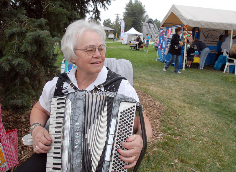 Celia Gustun plays the accordion at Broomfield Days on Saturday.<br /> <br /> September 18, 2010<br /> staff photo/David R. Jennings