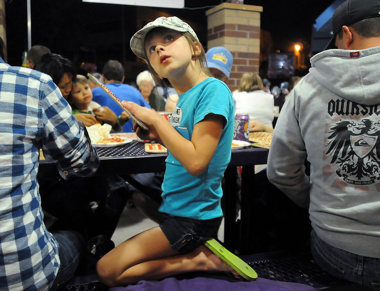 Nadia John, 8, checks numbers during the Lions Club bingo on Friday  night for Broomfield Days.<br /> <br /> September 17, 2010<br /> staff photo/David R. Jennings