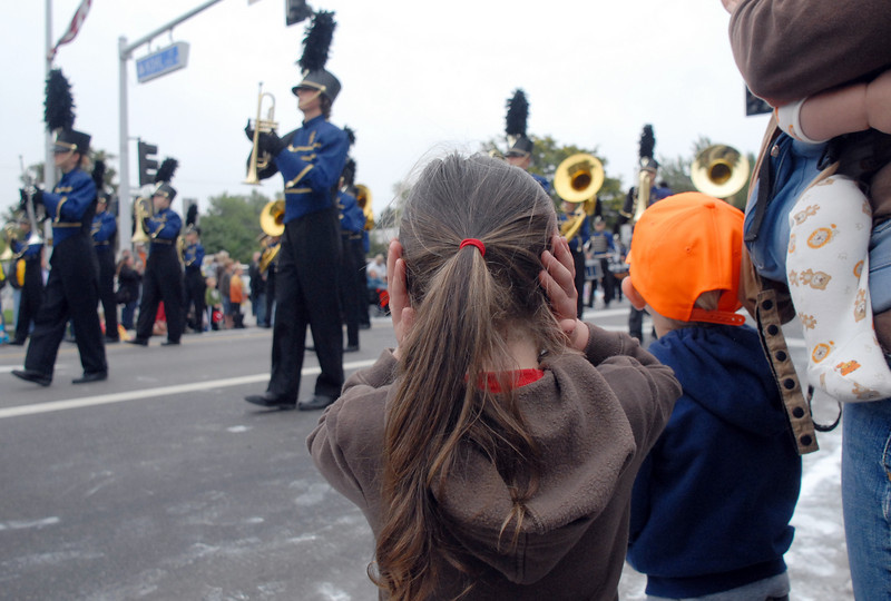 Lydia Dahlke, 3, holds her ears while watching the Legacy High band march by during the parade at Broomfield Days on Saturday.<br /> <br /> September 18, 2010<br /> staff photo/David R. Jennings