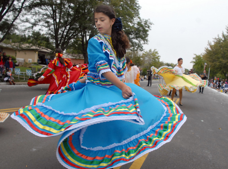 Guillermina Morales, 11, dances with the Three Margaritas entry in the parade at Broomfield Days on Saturday.<br /> <br /> September 18, 2010<br /> staff photo/David R. Jennings