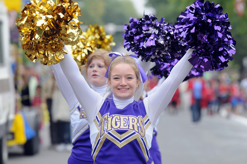 Holy Family cheerleader Sarah Gambell cheers during the parade at Broomfield Days on Saturday.<br /> <br /> September 18, 2010<br /> staff photo/David R. Jennings