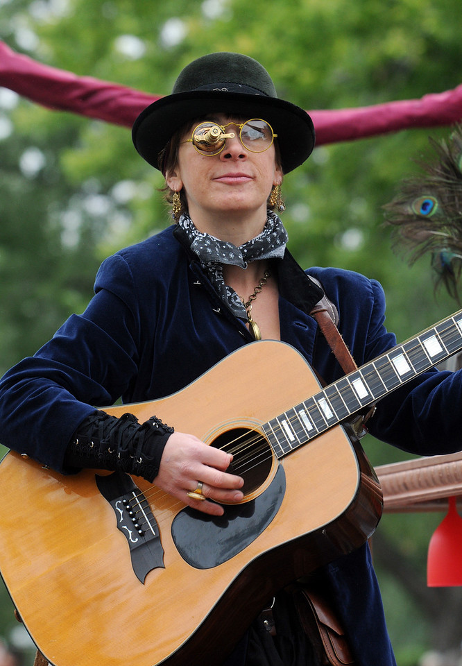 Gretchen Kunz plays the guitar with the Gristle Gals during the parade at Broomfield Days on Saturday.<br /> <br /> September 18, 2010<br /> staff photo/David R. Jennings